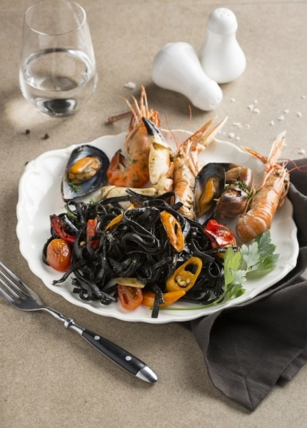 SO Sofitel spicy seafood garlic & fresh herbs black ink linguini product photo